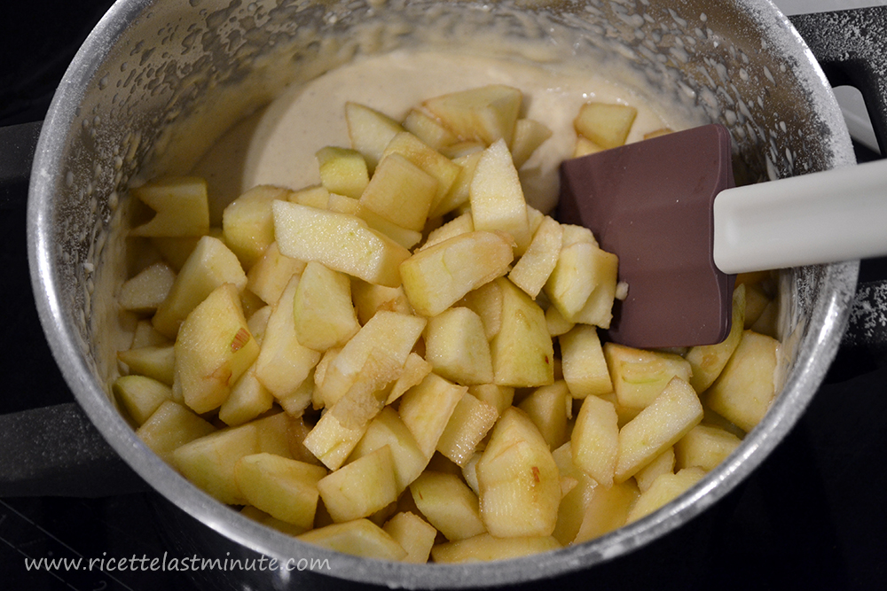 Adding apple pieces to the apple pie mixture