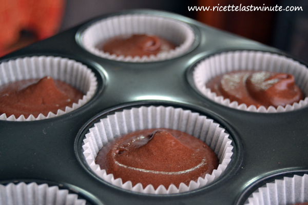 Baking cups filled with muffin dough